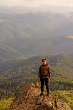 Young boy, tourist, portrait photos of a guy in the Carpathian mountains, picturesque and impressive Ukrainian Carpathians, view from the mountain Pip Ivan Chornohirsky. 2020 Фото со стока