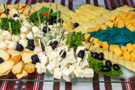 Snacks at the wedding, cheese, sausage, vegetables, meat products, Cossack table at the Ukrainian wedding. 2020