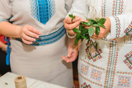 Wedding traditions in Ukraine, periwinkle wreath for the bride on her wedding day from her parents. 2020