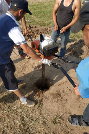 Kaluga, Russia June 11, 2019: manual drilling with the installation of drilling pneumatic shock STIHL.new
