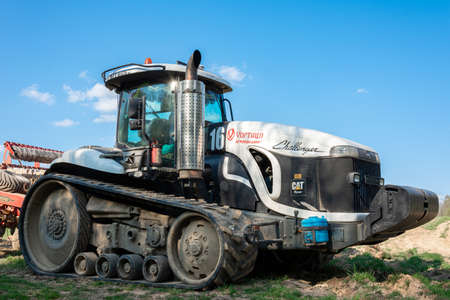 Dolyna, Ukraine April 29, 2020: agro-industrial machinery will cultivate the fields, a tractor of a challender company on caterpillars, an agricultural firm Khortytsia.new