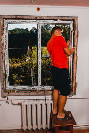 Dolyna, Ukraine July 31, 2020: installation and replacement of a plastic window, windows from wds, plastic window frame.new Editoriali