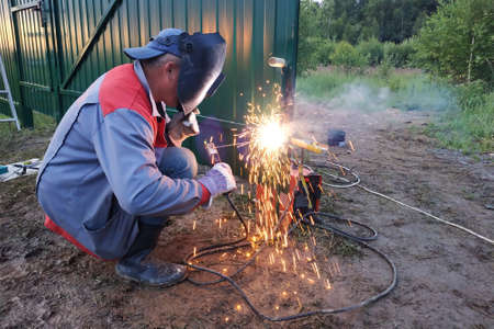 arc welding is a power tool, welding a metal fence, construction work.new