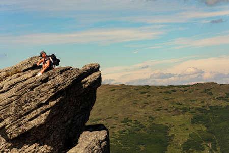A man on one of the peaks of Carpathian beauties, Carpathian mountains, Montenegrin ridge, Eared Stone mountain. 2020
