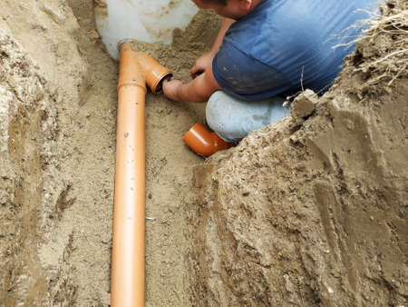 Supply of a sewer pipe to a sump by a master locksmith in the countryside. 2019