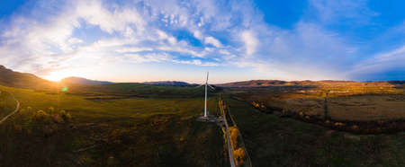 Panoramic landscape from the country road to the wind turbine, the development of wind energy in Ukraine. new