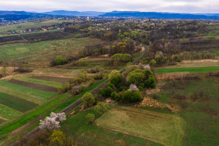 Panoramic view of the mountain village, the Carpathian village in Ukraine, roads and agricultural fields. new