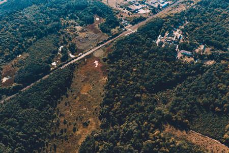 Forest and village in Ukraine, flight over the village of Klevan, view of the love tunnel from above. new