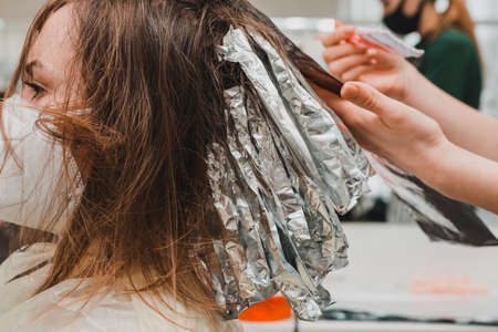 The work of hairdressers during the world quarantine, the process of applying hair dye. new