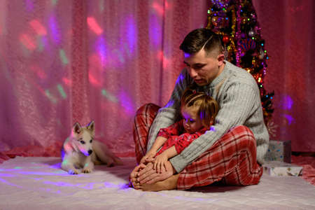 Family Christmas photography with a Siberian Husky. new