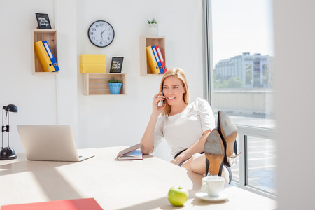 Beautiful young woman in office Stock Photo