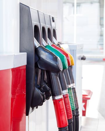 coded: Color coded fuel nozzles at petrol station. Vertical image Stock Photo