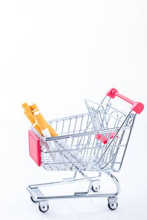 Cigarettes in shopping cart, isolated on white background,Cigarettes in supermarket trolleys