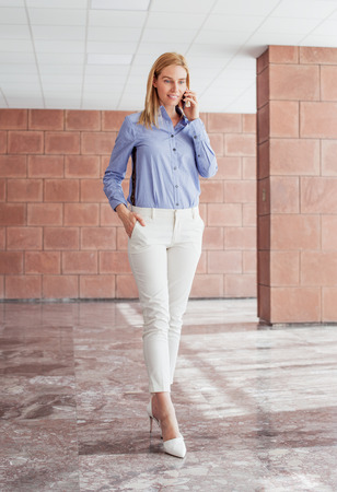 Beautiful young woman in office hall
