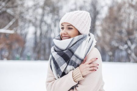 Portrait of a beautiful blonde woman in in the snow Stock Photo