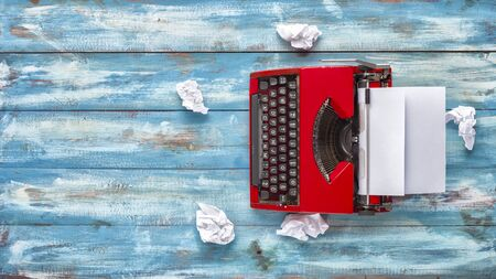Journalists single Equipment. Old typewriter and crumpled paper on the vintage background. The old concept