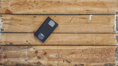 videocassette: Video cassette close-up on vintage wooden background Foto de archivo