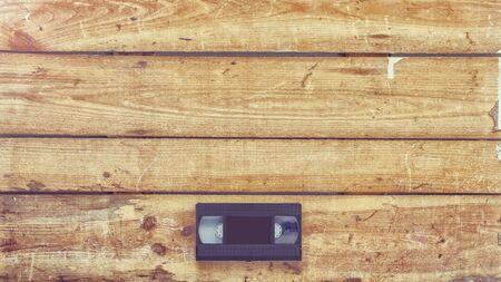 videocassette: Video cassette close-up en el fondo de madera de época Foto de archivo