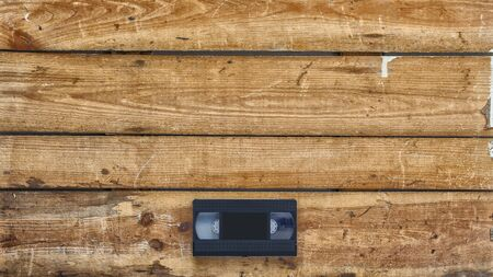 videocassette: Video cassette close-up on vintage wooden background Foto de archivo