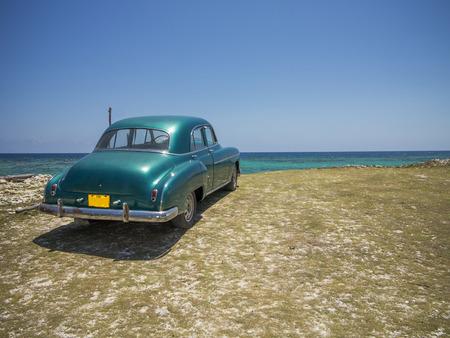 Cuba car on a beach 写真素材