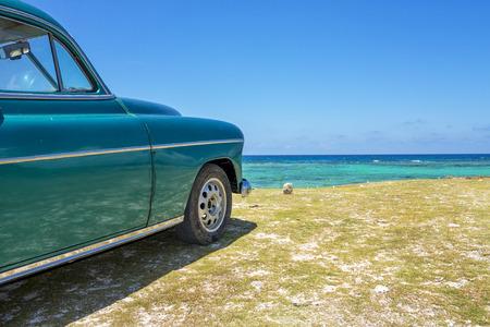 antique car: Old car on a beach