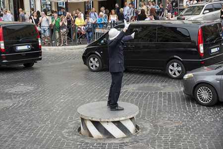 traffic warden: Rome 05152015: the policeman called quotpizzardonequot in Piazza Venezia in Rome is an institutionhistorical. On his footboardit he has become one of the tourists attractions in the city