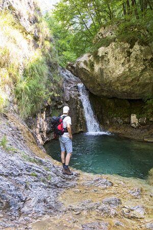man waterfalls: Watching the waterfall Stock Photo