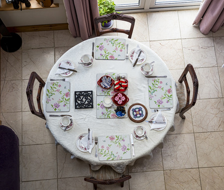 round table: Breakfast on a round table high angle view
