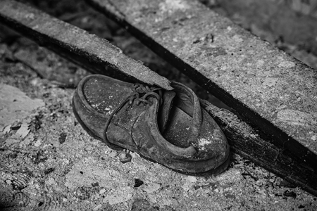 tearing down: Abandoned shoe
