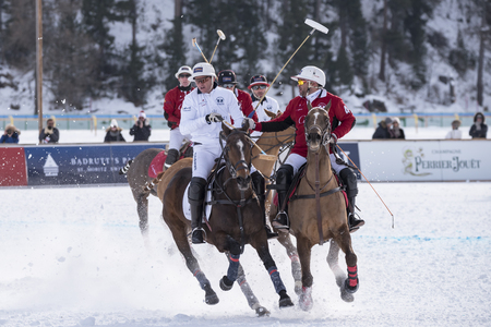 action: St. Moritz  Switzerland  - January 30,2016: Game actions at the Snow Polo World Cup St.Moritz 2016