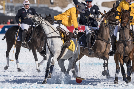 elites: St. Moritz  Switzerland  - January 30,2016: Game actions at the Snow Polo World Cup St.Moritz 2016