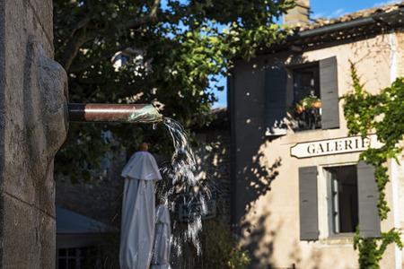 gordes: Fountain in Gordes ( France ) Stock Photo