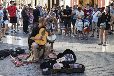 avignon: Avignon ( France ) 07262016: during the festival period in Avignon ( France ) streets are full of artists that performs music, acting or other street arts entertaining the people in the city