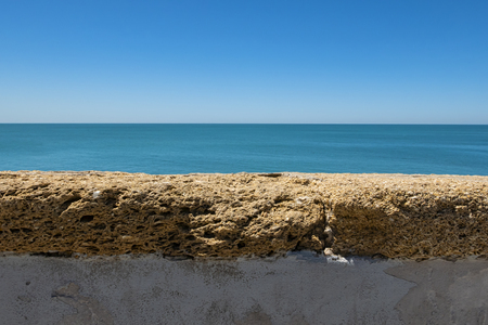 Landscape of the sea behind a wall