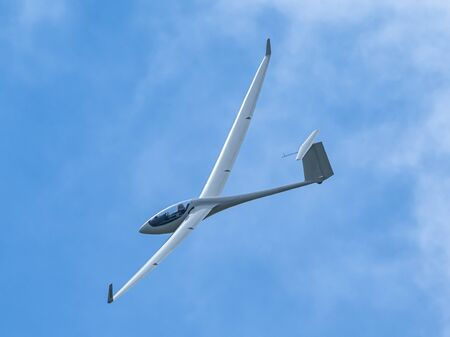 Glider plane flying in the clouds