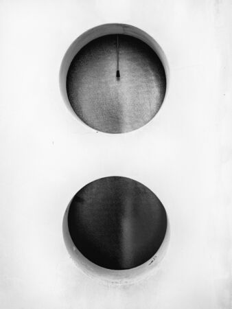 Two circular windows in black and white