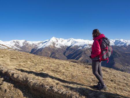Woman backpacker in the italian alps