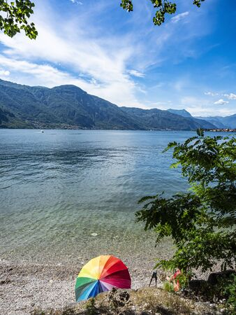 Relax on a beach of Lake Como after a trekking session