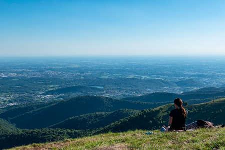 Hiker admiring the landscape from mount Bolettone