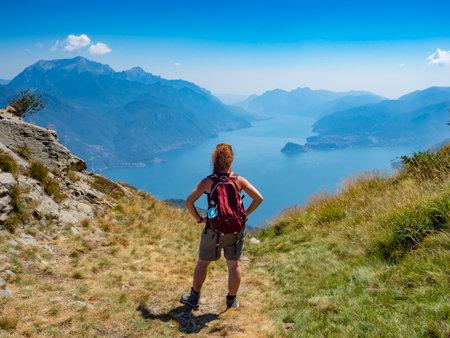Trekking scene on Lake Como alps Foto de archivo
