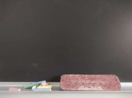 Blackboard detail with chalk and eraser