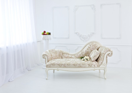 luxurious sofa: The interior of the Renaissance and baroque with a white couch