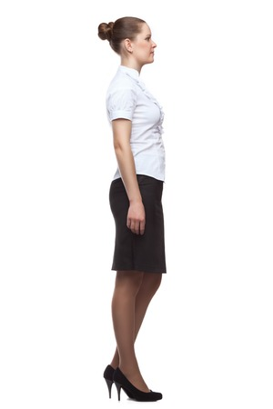 profile: Profile of a young woman dressed in office-style full-length isolated on white background.