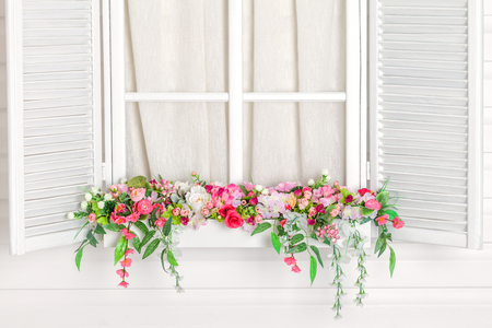 white window: Blooming flower bed under the window. Nursery. White window. Windowsill with flowers