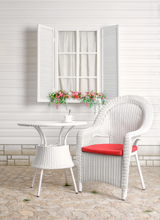 recreation area: Rural summer recreation area. Wicker furniture. Flower bed by the window. Stock Photo