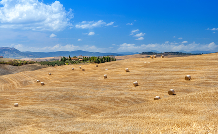 Rural landscapes of Tuscany, Italy, Europe. Lots of round bales and haystacks on the hills and fields. Agriculture.
