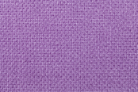 amethyst rough: light purple background from a textile material. Fabric with natural texture. Cloth backdrop.
