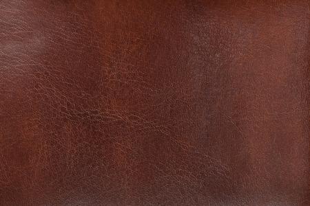 Natürliche Beschaffenheit des gealterten braunen Leders. Nahansicht. Standard-Bild