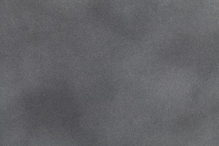 Light gray suede fabric closeup. Velvet texture background