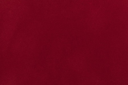 maroon leather: Dark red suede fabric closeup. Velvet texture background